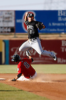 Brandon Crawford -  2009 San Jose Giants (California League) attempts a double play over a sliding Juan Diaz against the High Desert Mavericks at Maverick Stadium, Adelanto, CA - 04/26/2009..Photo by:  Bill Mitchell/Four Seam Images