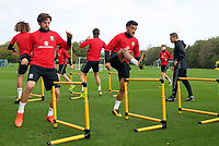 Pictured: (L-R) Joe Allen and Neil Taylor warm up. Monday 02 October 2017<br />Re: Wales football training, ahead of their FIFA Word Cup 2018 qualifier against Georgia, Vale Resort, near Cardiff, Wales, UK.