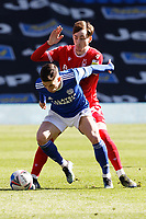Harry Wilson of Cardiff City (FRONT) challenged by James Garner of Nottingham Forest during the Sky Bet Championship match between Cardiff City and Nottingham Forest at the Cardiff City Stadium, Cardiff, Wales, UK. Friday 02 April 2021