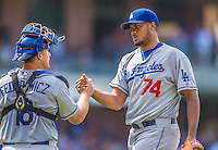 23 June 2013: Los Angeles Dodgers pitcher Kenley Jansen gets congratulated for closing out the game by catcher Tim Federowicz after a game against the San Diego Padres at Petco Park in San Diego, California. The Dodgers defeated the Padres 3-1, splitting their 4-game Divisional Series at 2-2. Mandatory Credit: Ed Wolfstein Photo *** RAW (NEF) Image File Available ***
