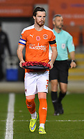 Blackpool's James Husband brings the wreath to the pitch<br /> <br /> Photographer Dave Howarth/CameraSport<br /> <br /> EFL Trophy - Northern Section - Group G - Blackpool v Leeds United U21 - Wednesday 11th November 2020 - Bloomfield Road - Blackpool<br />  <br /> World Copyright © 2020 CameraSport. All rights reserved. 43 Linden Ave. Countesthorpe. Leicester. England. LE8 5PG - Tel: +44 (0) 116 277 4147 - admin@camerasport.com - www.camerasport.com