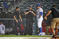 Buffalo Bisons designated hitter Jesus Montero (48) talks with umpires Robert Moreno (left) and Max Guyll at the start of a rain delay during a game against the Lehigh Valley IronPigs on July 9, 2016 at Coca-Cola Field in Buffalo, New York.  Lehigh Valley defeated Buffalo 9-1 in a rain shortened game.  (Mike Janes/Four Seam Images)