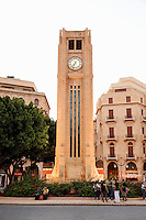 Young people socialise and gather beneath the Clocktower at Place d'Etoile (Nejmeh Square) at dusk, Beirut, Lebanon