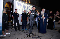 Pictured: Chronis Chlitsios speaks to the public after breaking the static apnea record in Volos, Greece<br /> Re: A World record in static apnea was broken in Volos, Greece by free diving champion, Chronis Chlitsios, scoring time 14 minutes, 18 seconds and 33 hundredths of a second.<br /> The record was attended by a crowd that flocked in the courtyard of the Church of Saints Constantine and Helen, by the seaside, to watch the Greek champion's attempt as part of the town's Maritime Week.<br /> A special tank with water was installed, in which the athlete went in just before 9 pm. Before commencing in his attempt, he prepared for 20 minutes, in which he gradually inhaled pure oxygen. Around 21:15, after he completed the necessary stage of meditation, Chronis Chlitsios dived into the tank.<br /> The previous record stood at 11 minutes and 35 seconds.