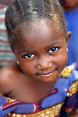 Gambia. Girl with tightly plaited hair.