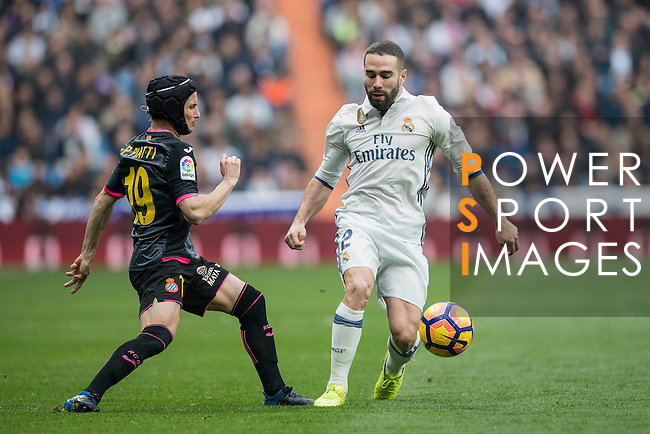 Daniel Carvajal Ramos of Real Madrid fights for the ball with Pablo Daniel Piatti of RCD Espanyol during the match Real Madrid vs RCD Espanyol, a La Liga match at the Santiago Bernabeu Stadium on 18 February 2017 in Madrid, Spain. Photo by Diego Gonzalez Souto / Power Sport Images