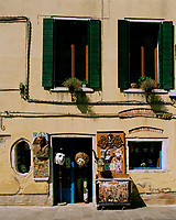 A traditional mask shop in an ageing building in Venice.