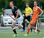 GER - Mannheim, Germany, May 16: During the whitsun tournament boys hockey match between Germany (black) and The Netherlands (orange) on May 16, 2016 at Mannheimer HC in Mannheim, Germany. Final score 4-3 (HT 2-0). (Photo by Dirk Markgraf / www.265-images.com) *** Local caption *** Justus Weigand #23 of Germany (U16), Ward Maakal #8 of The Netherlands
