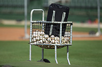 Batting practice baseballs sit in a basket prior to the South Atlantic League game between the Lakewood BlueClaws and the Kannapolis Intimidators at Kannapolis Intimidators Stadium on April 6, 2017 in Kannapolis, North Carolina.  The BlueClaws defeated the Intimidators 7-5.  (Brian Westerholt/Four Seam Images)