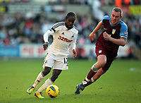 Pictured L-R: Nathan Dyer of Swansea marked by Richard Dunne of Aston Villa. Sunday 27 November 2011<br /> Re: Premier League football Swansea City FC v Aston Villa at the Liberty Stadium, south Wales.