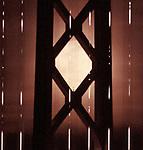 Super moon rising behind the Oakland Bay Bridge seen from Pier 1, San Francisco, CA.