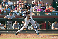 Salt River Rafters center fielder Monte Harrison (4), of the Miami Marlins organization, at bat during the Arizona Fall League Championship Game against the Peoria Javelinas at Scottsdale Stadium on November 17, 2018 in Scottsdale, Arizona. Peoria defeated Salt River 3-2 in 10 innings. (Zachary Lucy/Four Seam Images)