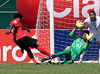 Roberto Lopez (12) of Honduras saves the shot of Christopher Nanco (11) of Canada during the group stage of the CONCACAF Men's Under 17 Championship at Catherine Hall Stadium in Montego Bay, Jamaica. Canada tied Honduras, 0-0.