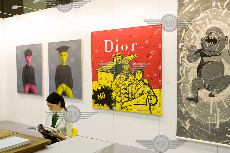 Artwork commenting on China's transition to consumerism, placing Chinese soldiers and peasants alongside the fashion brand Christian Dior, on display at the 4th China International Gallery Exposition 2007 (CIGE 2007). The Chinese art market has seen a meteoric rise in recent years with foreign art collectors flocking to buy works from Chinese galleries and artists.