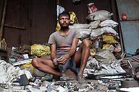 A man sorts through E-Waste in a used electronics market in central Kolkata.<br /> <br /> To license this image, please contact the National Geographic Creative Collection:<br /> <br /> Image ID: 1925721 <br />  <br /> Email: natgeocreative@ngs.org<br /> <br /> Telephone: 202 857 7537 / Toll Free 800 434 2244<br /> <br /> National Geographic Creative<br /> 1145 17th St NW, Washington DC 20036