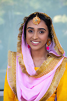 Indian Woman Wearing Traditional Pink & Yellow Clothing, Renton Multicultural Festival 2017, WA, USA.