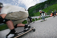 Championship winner Alex Lyngaas films during a post competition fun and film run. The first ever Norwegian Longboarding Championship was held during the Extreme Sport Week, an annual event that draws adrenalin junkies to the small Norwegian mountain town of Voss. © Fredrik Naumann