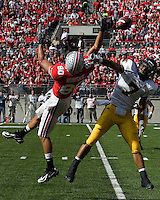 Ohio State wide receiver Brian Robiskie (80) and Kent State defensive back Rico Murray (7) fight for the ball.  The Ohio State Buckeyes defeated the Kent State Golden Flashes 48-3 on  October 13, 2007 at Ohio Stadium, Columbus, Ohio.