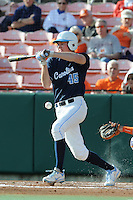 Right Fielder Michael Russell #45 of the North Carolina Tar Heels fouls off a pitch during  a game against the Clemson Tigers at Doug Kingsmore Stadium on March 9, 2012 in Clemson, South Carolina. The Tar Heels defeated the Tigers 4-3. Tony Farlow/Four Seam Images.