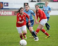 Finale Beker van West-Vlaanderen Dames : FC Menen United - KEG Gistel : duel tussen Evelyn Declerck (r) , Shannen Holvoet en Tatjana Ryckewaert (l) <br /> foto VDB / BART VANDENBROUCKE