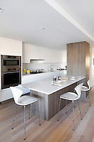 Contemporary open plan kitchen with bar stools