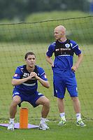 Hogan Ephraim and Andy Johnson of QPR in training