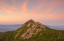 The pink hues of dawn over Mount Chocorua, New Hampshires White Mountain Region.