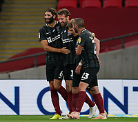 Andy Williams of Northampton Town (2nd left) celebrates after he scores his team's fourth goal during the Sky Bet League 2 PLAY-OFF Final match between Exeter City and Northampton Town at Wembley Stadium, London, England on 29 June 2020. Photo by Andy Rowland.