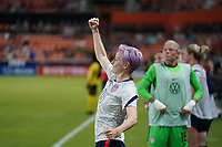 HOUSTON, TX - JUNE 13: Megan Rapinoe #15 of the United States roots on her USWNT team mates during a game between Jamaica and USWNT at BBVA Stadium on June 13, 2021 in Houston, Texas.