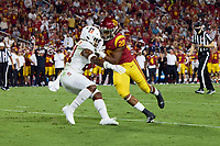 LOS ANGELES, CA - SEPTEMBER 11: Kendall Williamson #21 of the Stanford Cardinal prepares to tackle Keaontay Ingram #28 of the USC Trojans during a game between University of Southern California and Stanford Football at Los Angeles Memorial Coliseum on September 11, 2021 in Los Angeles, California.