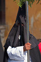 Antigua, Guatemala.  Holy Saturday, Procession of the Virgin of Solitude (Virgen de Soledad), Holy Week, La Semana Santa.  Nazarenos wearing Capuchas, Black Conical Hoods.