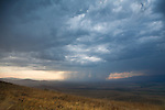 Dramatic storm clouds and rain falling in western montana