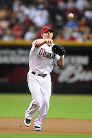 Jul. 23, 2010; Phoenix, AZ, USA; Arizona Diamondbacks shortstop Stephen Drew throws to first base for an out in the first inning against the San Francisco Giants at Chase Field. Mandatory Credit: Mark J. Rebilas-