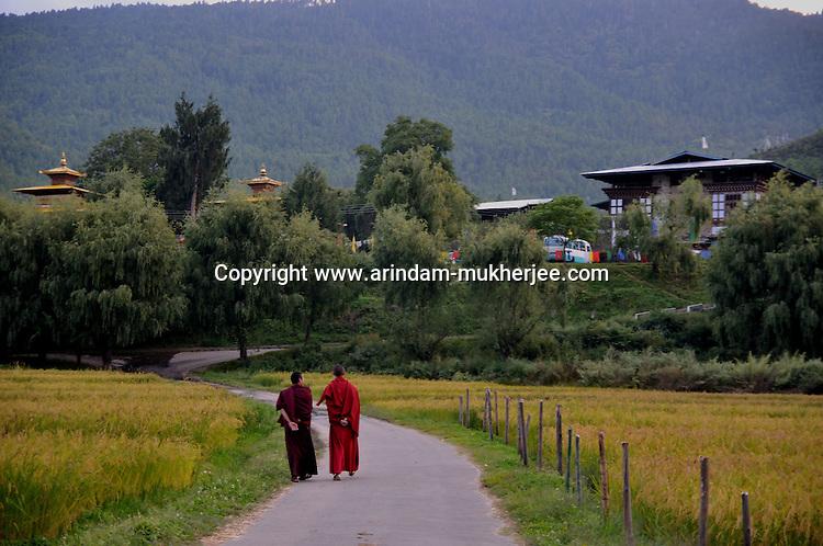 Buddhist lamas on a road in Paro. Arindam Mukherjee. Arindam Mukherjee..