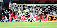 WASHINTON, DC - FEBRUARY 29: Washington, D.C. - February 29, 2020: Bill Hamid #24 of D.C. United battles the ball with Drew Moor #3 of the Colorado Rapids. The Colorado Rapids defeated D.C. United 2-1 during their Major League Soccer (MLS)  match at Audi Field during a game between Colorado Rapids and D.C. United at Audi FIeld on February 29, 2020 in Washinton, DC.