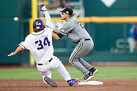 Vanderbilt Commodores second baseman Tyler Campbell (2) waits for a throw as TCU baserunner Garrett Crain (34) slides into second base during the NCAA College baseball World Series against the TCU Horned Frogs on June 16, 2015 at TD Ameritrade Park in Omaha, Nebraska. Vanderbilt defeated TCU 1-0. (Andrew Woolley/Four Seam Images)