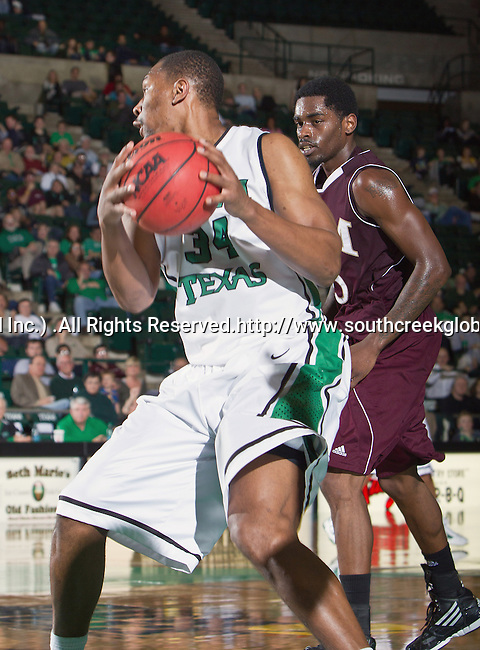 North Texas Mean Green forward Alonzo Edwards (34) in action during the game between the Louisiana Monroe Warhawks and the University of North Texas Mean Green at the North Texas Coliseum,the Super Pit, in Denton, Texas. UNT defeats ULM 86 to 51...