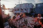 Seattle, Lake Union, houseboats, sailboats, lakeside lifestyle, summer dinner, Washington State, Pacific Northwest, USA,.