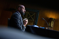 Judith McMeekin, Associate Commissioner for Regulatory Affairs at the Food and Drug Administration (FDA), right, and Mark Abdoo, Associate Commissioner for Global Policy and Strategy at the Food and Drug Administration (FDA), listen during the United States Senate Committee on Finance hearing regarding the inspection process of foreign drug manufacturing on Capitol Hill in Washington D.C., U.S., on Tuesday, June 2, 2020.  Credit: Stefani Reynolds / CNP/AdMedia