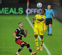 WASHINGTON, DC - OCTOBER 28: Luis Diaz #12 of Columbus Crew SC heads the ball against Joseph Mora #28 of D.C. United during a game between Columbus Crew and D.C. United at Audi Field on October 28, 2020 in Washington, DC.