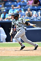 Augusta GreenJackets right fielder Sandro Fabian (6) swings at a pitch during a game against the Asheville Tourists at McCormick Field on July 16, 2017 in Asheville, North Carolina. The GreenJackets defeated the Tourists 10-9. (Tony Farlow/Four Seam Images)