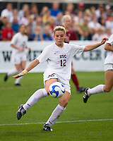 USC forward Amy Rodriguez (12) strikes the ball.  The University of Southern California defeated Florida State University 2-0 to win the 2007 women's NCAA College Cup in College Station, TX on December 9, 2007.