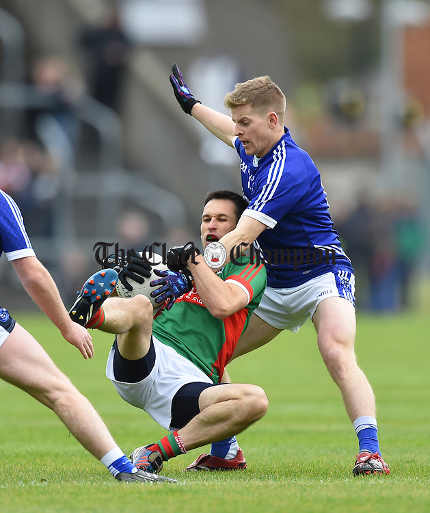 Michael O Dwyer of  Kilmurry Ibrickane in action against Podge Collins of Cratloe during their senior football final replay at Cusack park. Photograph by John Kelly.