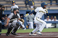 Michigan Wolverines outfielder Christian Bullock (5) follows through on his swing against the Western Michigan Broncos on March 18, 2019 in the NCAA baseball game at Ray Fisher Stadium in Ann Arbor, Michigan. Michigan defeated Western Michigan 12-5. (Andrew Woolley/Four Seam Images)