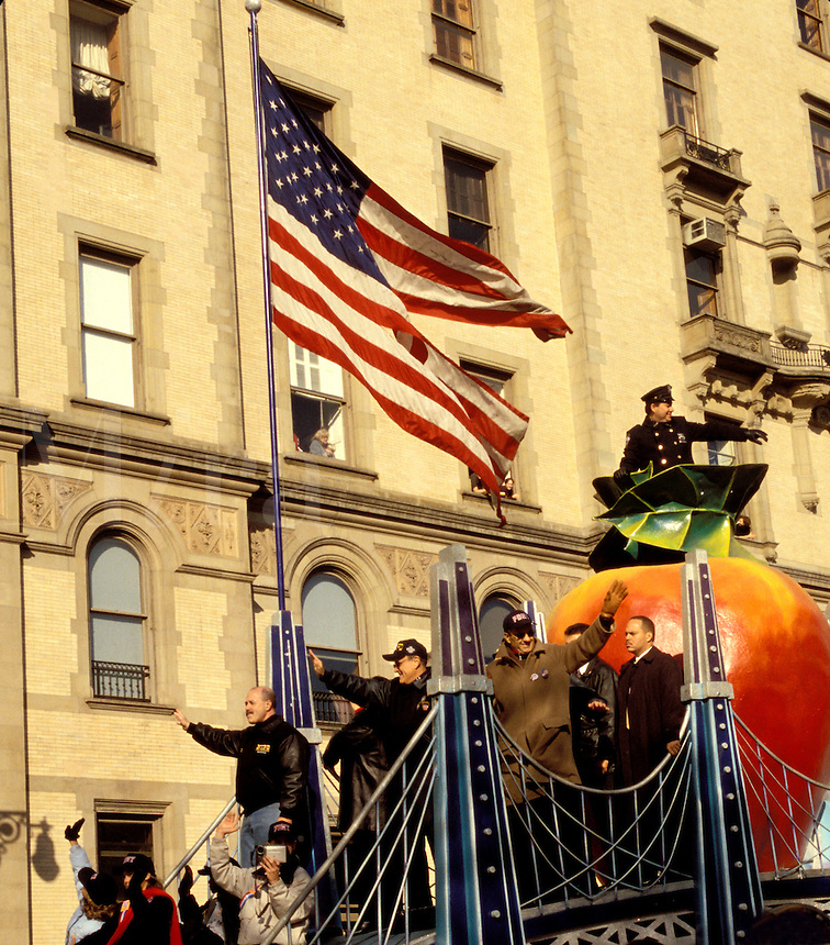 9/11 Flag  Thanksgiving Parade 2001  Big Apple Float with Rudolf Guilani, Joe Tores and other NYC officials.  New York City  Central Park West