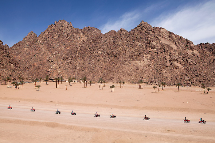 """Sharm el Sheikh, March 2015. A group on quad bikes on an expedition in the desert. Such trips are included in the """"all inclusive"""" package, sold by tour operators. The trip usually includes a camel ride and a """"Bedouin dinner"""" with a belly dancer show."""