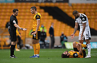 Wolverhampton Wanderers' Captain Conor Coady complains to referee Darren England after Fulham's Aleksandar Mitrovic (right) on Wolverhampton Wanderers' Ruben Neves <br /> <br /> Photographer David Horton/CameraSport<br /> <br /> The Premier League - Wolverhampton Wanderers v Fulham - Sunday 4th October 2020 - Molineux Stadium - Wolverhampton<br /> <br /> World Copyright © 2020 CameraSport. All rights reserved. 43 Linden Ave. Countesthorpe. Leicester. England. LE8 5PG - Tel: +44 (0) 116 277 4147 - admin@camerasport.com - www.camerasport.com