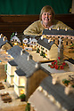 """08/12/16<br /> <br /> Lynn Nolan, 59, with her cake village.<br /> <br /> In this incredibly detailed replica of a small Peak District village, everything is edible, from the baubles on the Christmas trees to the flowers around the houses and what's more the """"village"""" is made from 35 individual rich fruit Christmas cakes which will be eaten on the 25th!<br /> <br /> The amazing model village is made up of 18 shops and houses, which are all realistic reproductions of the actual buildings found in Youlgreave, and is open to the public to view at All Saints' church, the main focal point of the miniature masterpiece.<br /> <br /> Retired florist Lynn Nolan, who decorated all the cakes, came up with the original idea as a way of raising money for the church, which needs a new roof, and the first of the cakes went in the oven back in April.<br /> <br /> MORE...https://fstoppressblog.wordpress.com/the-village-thats-really-a-christmas-cake/<br /> <br /> All Rights Reserved F Stop Press Ltd. (0)1773 550665   www.fstoppress.com"""