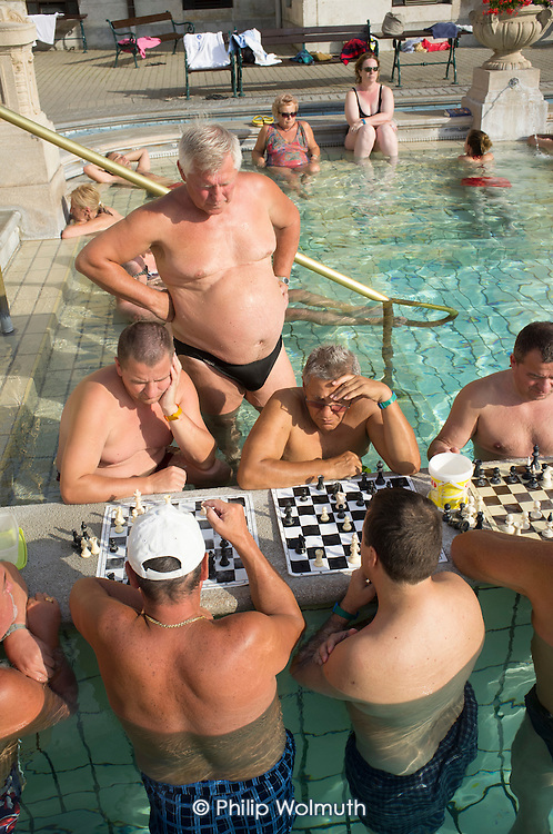Men play chess in the water at Szechenyi thermal baths, Budapest.