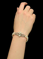 BNPS.co.uk (01202 558833)<br /> Pic: DixNoonanWebb/BNPS<br /> <br /> Pictured: The bracelet.<br /> <br /> A stunning bracelet Princess Margaret wore in her official 19th birthday photo was sold yesterday for £320,000 following an international bidding war - eight times its estimate.<br /> <br /> The Queen's younger sister sports the Art Deco cultured pearl and diamond bracelet in Royal photographer Cecil Beaton's 1949 portrait taken at Buckingham Palace.<br /> <br /> It is around her left arm as she is captured from the side in a white tulle embroidered dress against a landscape backdrop.<br /> <br /> The bracelet, which comes in a Cartier case and may have been made by the Paris jeweller, has a double row of cultured pearls bordering a line of circular-cut diamonds.<br /> <br /> It first emerged from the Countess of Snowdon collection 15 years ago and was today sold by a private collector with London-based auctioneers Dix Noonan Webb.